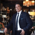 Douglas Manful Real Estate Agent at Black Book International